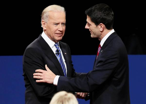 Biden and Ryan face off: U.S. Vice President Joe Biden shakes hands with Republican vice presidential nominee Paul Ryan at the start of the debate.