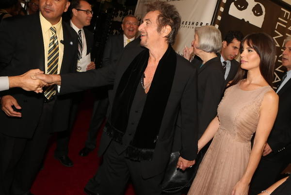 "Actor Al Pacino and girlfriend Lucila Sola arrive on the red carpet for the premiere of ""Stand Up Guys"" at Harris Theater October 11, 2012."