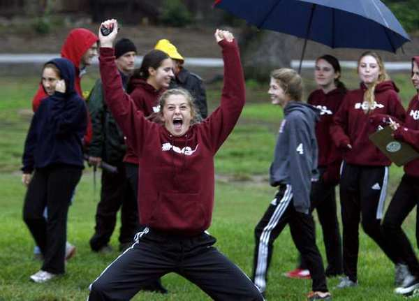 La Canada High runners celebrate after the Rio Hondo League Cross-Country meet was cancelled due to lightning at Lacy Park in San Marino.