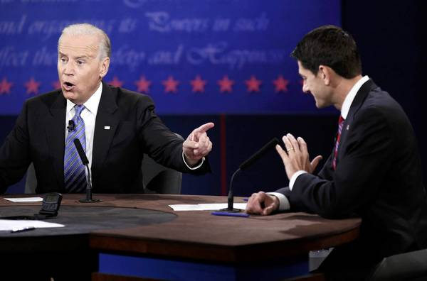 Biden and Ryan face off: U.S. Vice President Biden gestures towards Republican vice presidential nominee Ryan during the debate.