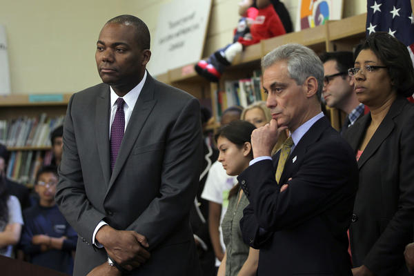 Chicago Mayor Rahm Emanuel and Chicago Public Schools CEO Jean-Claude Brizard listen to a question during a press conference at a Chicago school.