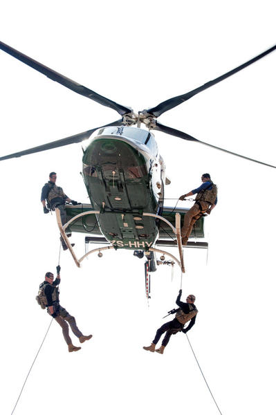 Section 20 agents drop from a helicopter onto a roof.