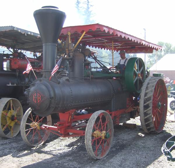 Brandon Barron checks the fire while the 1918 Peerless sits at an idle during the 2012 Farmers' and Threshermen's Jubilee.