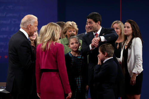 U.S. Vice President Joe Biden talks with Republican vice presidential candidate U.S. Rep. Paul Ryan (R-WI) surrounded by family after the debate.