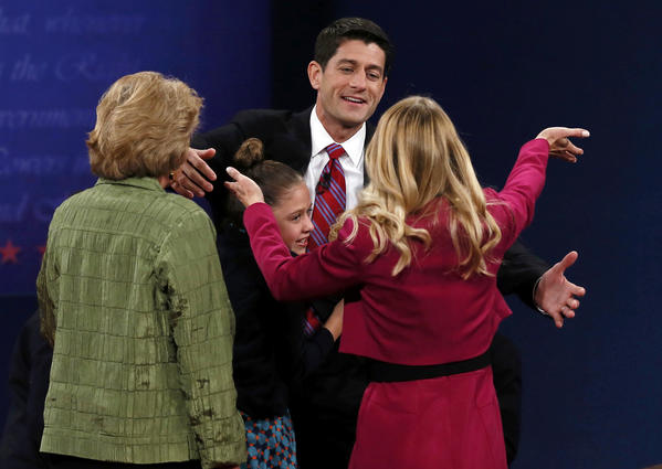 Biden and Ryan face off: Republican vice presidential nominee Paul Ryan is greeted by his wife Janna (R), daughter Liza and mother Betty (L) at the end of the vice presidential debate