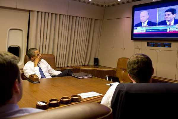 In an official White House photograph, President Obama and staff aboard Air Force One watch the vice presidential debate Thursday night between Vice President Joe Biden and Rep. Paul D. Ryan.