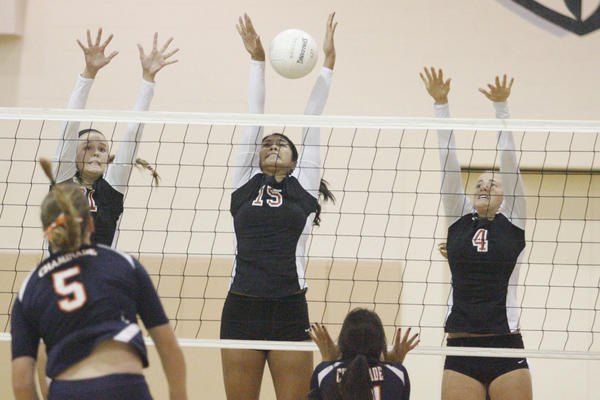FSHA's Katie Conley, from top left, Megan Bacall and Maddie Peterson block a spike during a game against Chaminade at Flintridge Sacred Heart Academy in La Canada on Thursday, October 11, 2012.