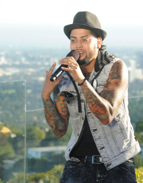 "David Correy performs in front of L.A. Reid and Justin Bieber on ""The X-Factor."""