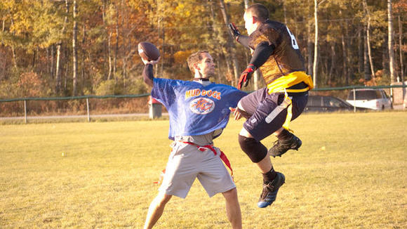 Quarterback Aaron Pegg tries to elude the rush of Michael Frazee during action this week in the Otsego County Parks and Recreation adult flag
