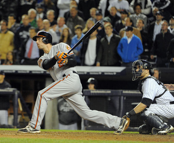 Orioles' J.J. Hardy gets an rbi double in the top of the 13th inning to give the Orioles the lead. Baltimore Orioles vs. New York Yankees in game four of the ALDS at Yankee Stadium. Lloyd Fox,
