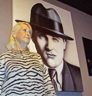 "Millicent Siegel Rosen stands in front of a portrait of her father, ""Bugsy"" Siegel, at the new Mob Experience at the Tropicana in Las Vegas. ""He pushed Vegas to become what it is today,"" she said of her father, who founded the Flamingo."
