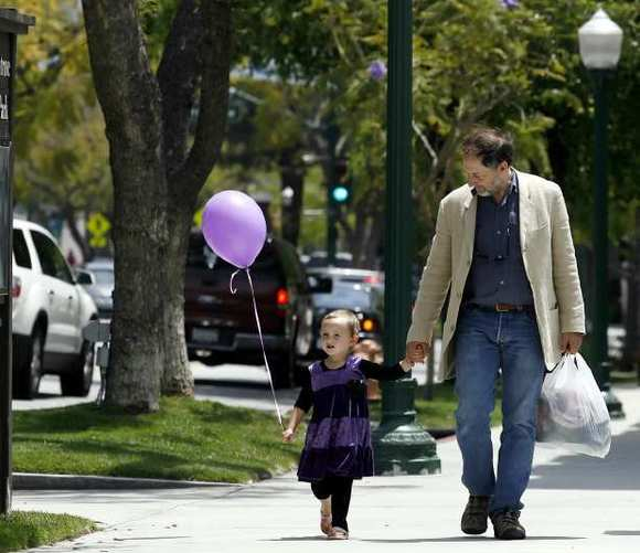 A man walks with his daughter after a morning of shopping in Montrose.