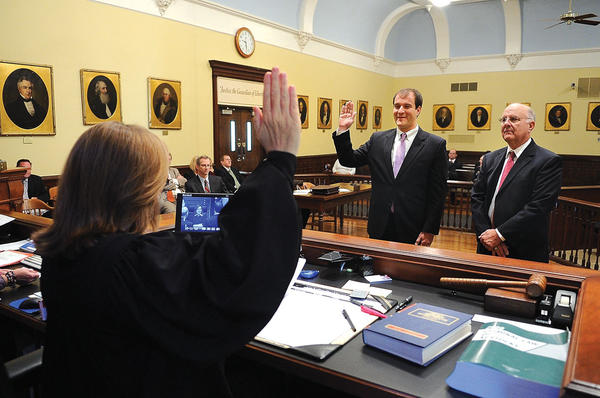 John Patrick Rompf was sworn in as the newest member of the Clark County Bar Association Thursday morning by Circuit Court Judge Jean Chenault Logue in the Clark County Courthouse. Presenting him to the court was his father, local attorney John Rompf. Rompf is a 2002 graduate of Lexington Catholic. He earned his undergraduate degree from the University of Notre Dame in 2006 and his law degree from the Law School at Notre Dame in 2012. Rompf will join his father at the law firm of White, McCann and Stewart of Winchester. Rompf, the son of John and Beth Rompf, is married to Erica Rompf and lives in Lexington.