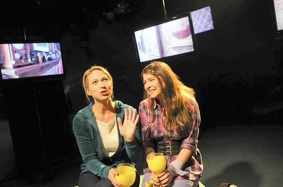 "Kendra Thulin and Leah Karpel in  ""Neighborhood 3: Requisition of Doom"" at Strawdog Theatre."
