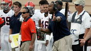 Virginia coach Mike London and defensive coordinator Jim Reid during loss at Duke