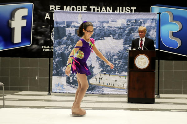 Brianna Hollister, 12, of Rocky Hill skates on a slippery synthetic surface in the atrium of the XL Center to promote Hartford Winterfest in Bushnell Park. In the background is former Hartford Whaler and ice rink entrepreneur Bob Crawford of Glastonbury. Crawford kicked off a regional skate drive that will encourage and permit anyone who does not own ice skates to continue to ice skate for free. Winterfest begins the day after Thanksgiving and extends until Jan. 21. Skate Drive drop-off locations include Hartford City Hall, Simsbury Town Hall, Veterans Memorial Rink in West Hartford and Champions Skating Rinks in Simsbury, Cromwell and Bolton. By the way, Brianna didn't get the whole day off from school as she planned to return for her afternoon classes on Wednseday.