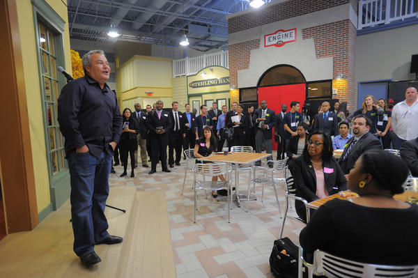 Vocus President and CEO Rick Rudman greets job-seekers at Vocus, a Beltsville-based software company. Vocus started with less than 100 employees in Lanham; they expect to expand by hiring about 1,000 employees by the end of 2013.