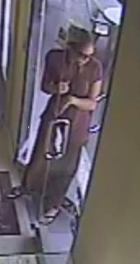 The female suspect, as seen on surveillance footage.