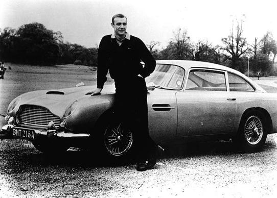 """Where's my Bentley?"" James Bond (Sean Connery) asks Q before being introduced to this Aston Martin DB5, outfitted with bulletproof windows, revolving license plates, defense mechanisms (smoke screen, oil slick, twin machine guns) and a little red button inside the gear lever that fires"