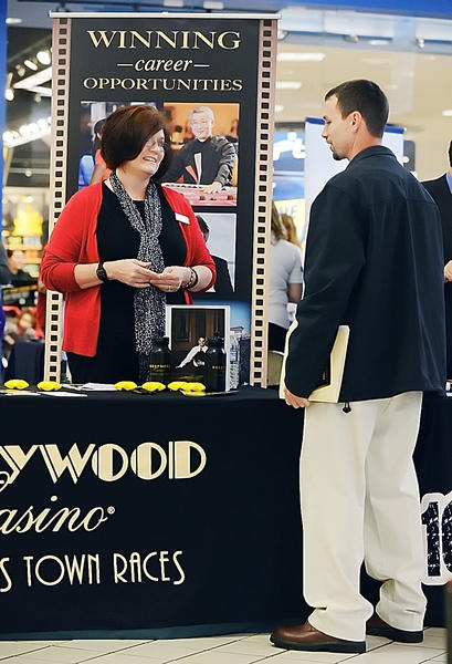 Toni Rose, left, Human Resources Administrator from Hollywood Casino at Charles Town Races talks with Thomas Custer of Hagerstown at the Autumn Job Fair held at Valley Mall on Friday.