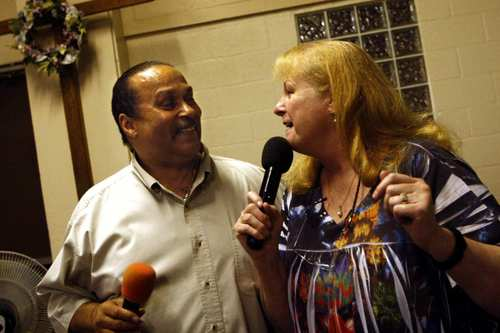 Pastor Tony Stallworth and his wife, Lucy, do a duet during karaoke night at the Central City Community Church of the Nazarene on skid row in Los Angeles on July 11, 2012. Lucy is the ongoing DJ who plays people's requests and Pastor Tony is the master of ceremonies. For the past 15 years the Stallworths have held a karaoke party every Wednesday night at their church for people living on the streets of skid row or those living in shelters and transitional housing.