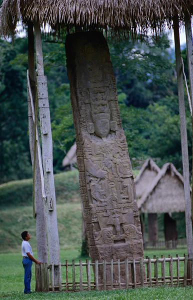 "Quirigua (pronounced Kiri-gua) is a relatively small site, almost directly across the border from Honduras' Copan. Strategically located on the Montagua River trade route, which was important for the transport of jade and obsidian, it was also originally a vassal of Copan. However, Quirigua rebelled and defeated Copan, then allied itself with Calakmul, after which it erected elaborate stone monuments in a style similar to that of Copan. In fact, one of the monuments at Quirigua, known as ""Stele E,"" is the largest known quarried stone in the Maya world, standing 35 ft tall and depicting a Mayan lord over three times life size."