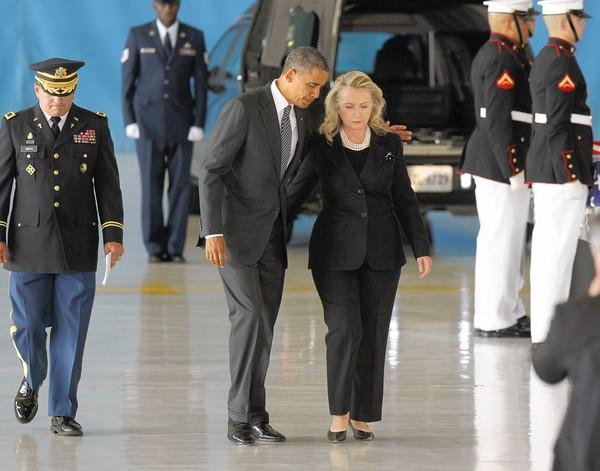 President Obama and Secretary of State Hillary Rodham Clinton attend a ceremony honoring the four Americans killed last month in Benghazi, Libya.