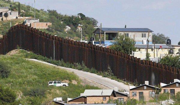 A U.S. Border Patrol vehicle keeps watch along the border fence in Nogales, Ariz. Agents opened fire on people throwing rocks at the border this week, killing a Mexican boy, 16.