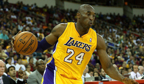 The Lakers' Kobe Bryant controls the ball against the Golden State Warriors on Oct. 7, 2012.