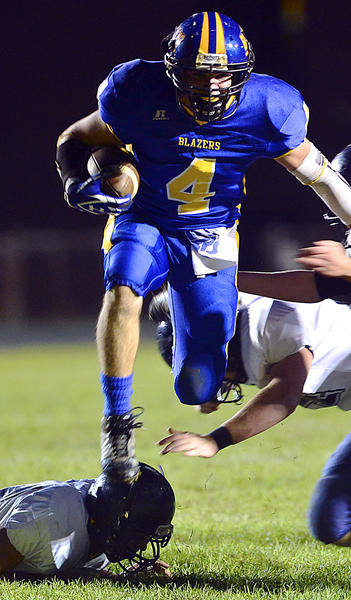 Clear Spring's Jared Brant breaks through Berkeley Springs' defense in the first half of Friday night's game at Clear Spring.