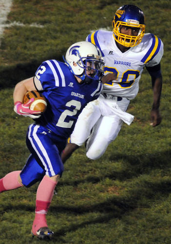 Southern Lehigh's Dylan Schmidt (2) gets past Wilson's Trey Robinson (20) during their football game on Friday at Southern Lehigh High School stadium.