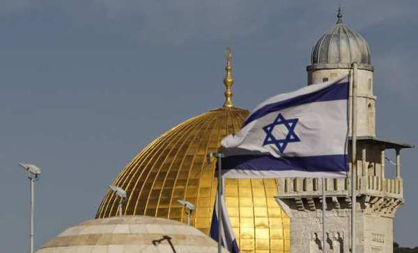 An Israeli flag waves over Jerusalem's Old City.