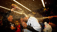 Plastic tarps covered the Yankees' lockers, and the smell of champagne hung in the air after the club's 3-1 series-clinching win over the pesky Orioles. But the New Yorkers kept their celebration in check, knowing they had another game the next evening against the Detroit Tigers in the American League Championship Series.