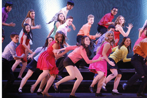 "Nia Johnson, center, and other cast members perform onstage during a John Burroughs High School Vocal Music Assn. performance, ""Burroughs on Broadway,"" which took place at John Burroughs High School in Burbank on Friday, October 12, 2012."