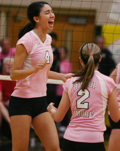 Bishop Moore's Lindsey Owens, 4, and Katie Truluck, 2, shown during a game against Winter Park, celebrate after a point. Bishop Moore is hosting the Swinging for a Cure volleyball tournament. (Stephen M. Dowell/Orlando Sentinel)
