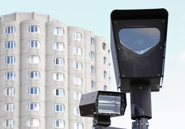 A Redflex red-light camera operates at West Cermak Road and South Canal Street Friday.