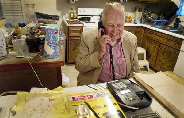 Ret. Col. John Babbs, 95, receives his daily morning check-up by phone call from the NN Sheriff's Office's Safety for Our Seniors program. The service is available free to seniors living alone.
