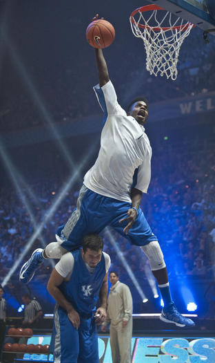Kentucky freshman Nerlens Noel dunks over teammate Sam Malone during Big Blue Madness Friday night at Rupp¿Arena.