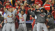 The St. Louis Cardinals celebrate after defeating the Washington Nationals, 9-7, in Game 5 of the National League Division Series