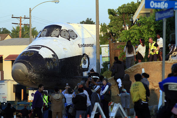 Endeavour creeps down Manchester Boulevard toward a stop at the Forum on its way to the California Science Center.