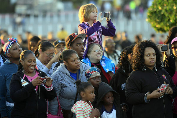Spectators get an early morning glimpse of the space shuttle Endeavour as it rolls down Manchester Boulevard.