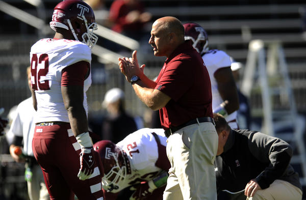 Temple coach and Connecticut native Steve Addazio talks to one of his players before taking on UConn.