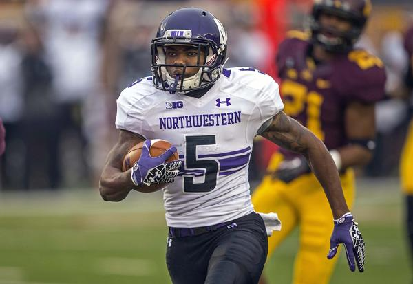 Northwestern running back Venric Mark runs for a 26-yard touchdown in the first quarter against Minnesota.