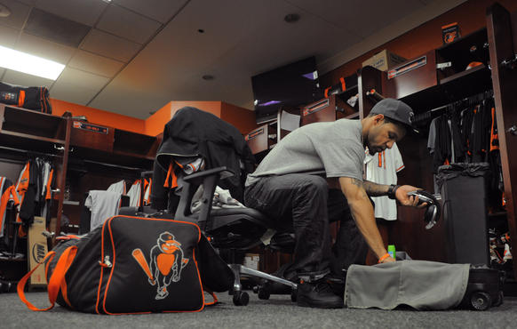 Orioles second baseman Robert Andino packs his things, clearing his locker at Camden Yards a day after the O's elimination from the postseason.