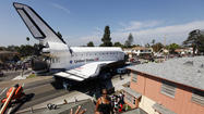 Space shuttle Endeavour rolls on toward its new home