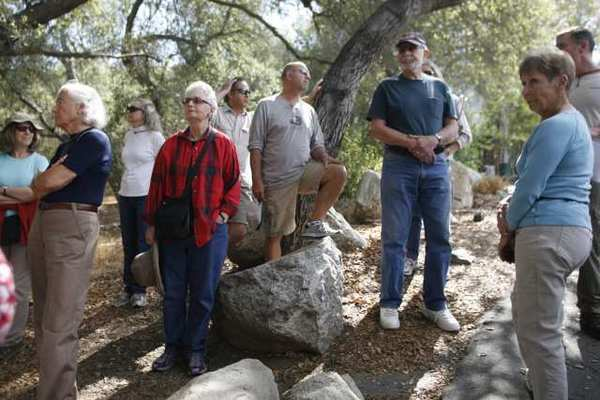 Visitors take a tour of the site of a four-acre oak woodland that Descanso Gardens plans to add.