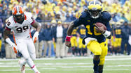 ANN ARBOR, Mich. — Two quarterback images represented the severe disparity between Michigan and Illinois in the Wolverines' 45-0 victory Saturday at Michigan Stadium.