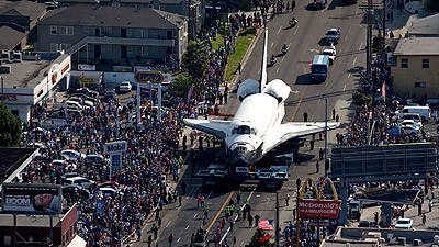 The space shuttle Endeavour traveles north on Crenshaw Boulevard near Florence Avenue en route to the California Science Center.