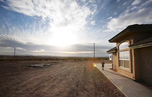 The desert stretches into the distance from one of the homes in Hinkley that Pacific Gas & Electric has offered to buy because of a plume of polluted groundwater.