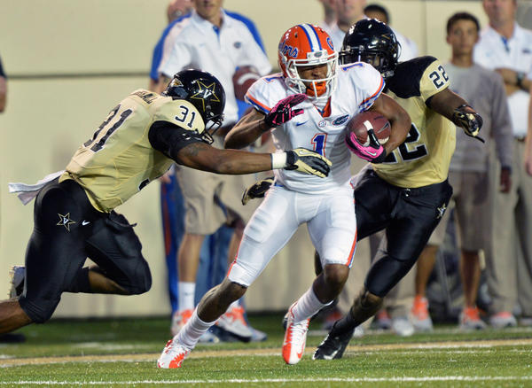 Florida Gators wide receiver Quinton Dunbar (1) runs with the ball after making a reception against Vanderbilt Commodores safety Javon Marshall during the first half at Vanderbilt Stadium.